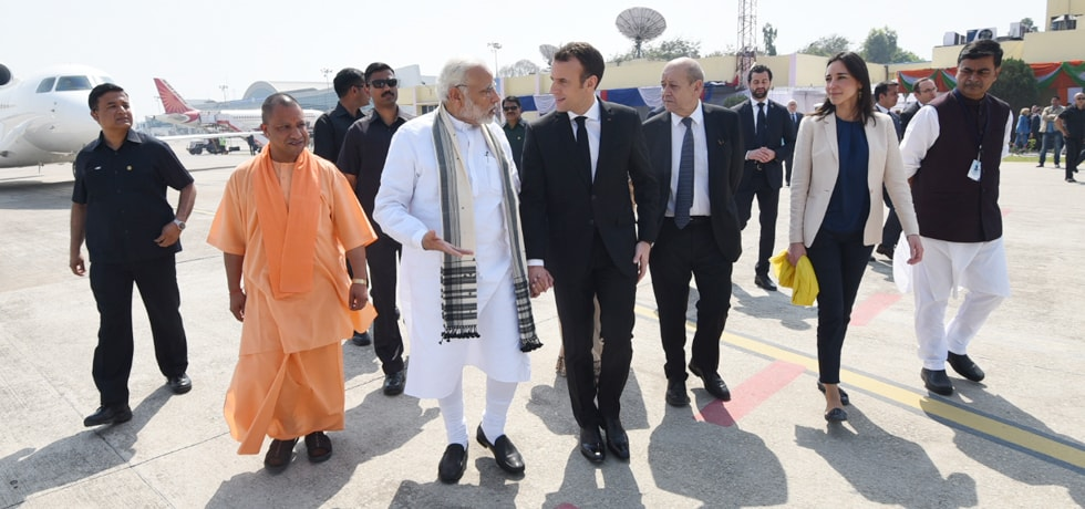 Prime Minister receives Emmanuel Macron, President of French Republic at Varanasi Airport