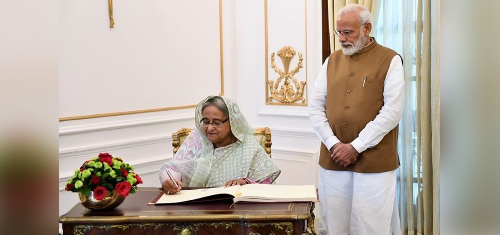 Sheikh Hasina, Prime Minister of Bangladesh signs Visitor's Book at Hyderabad House during her Official Visit to India